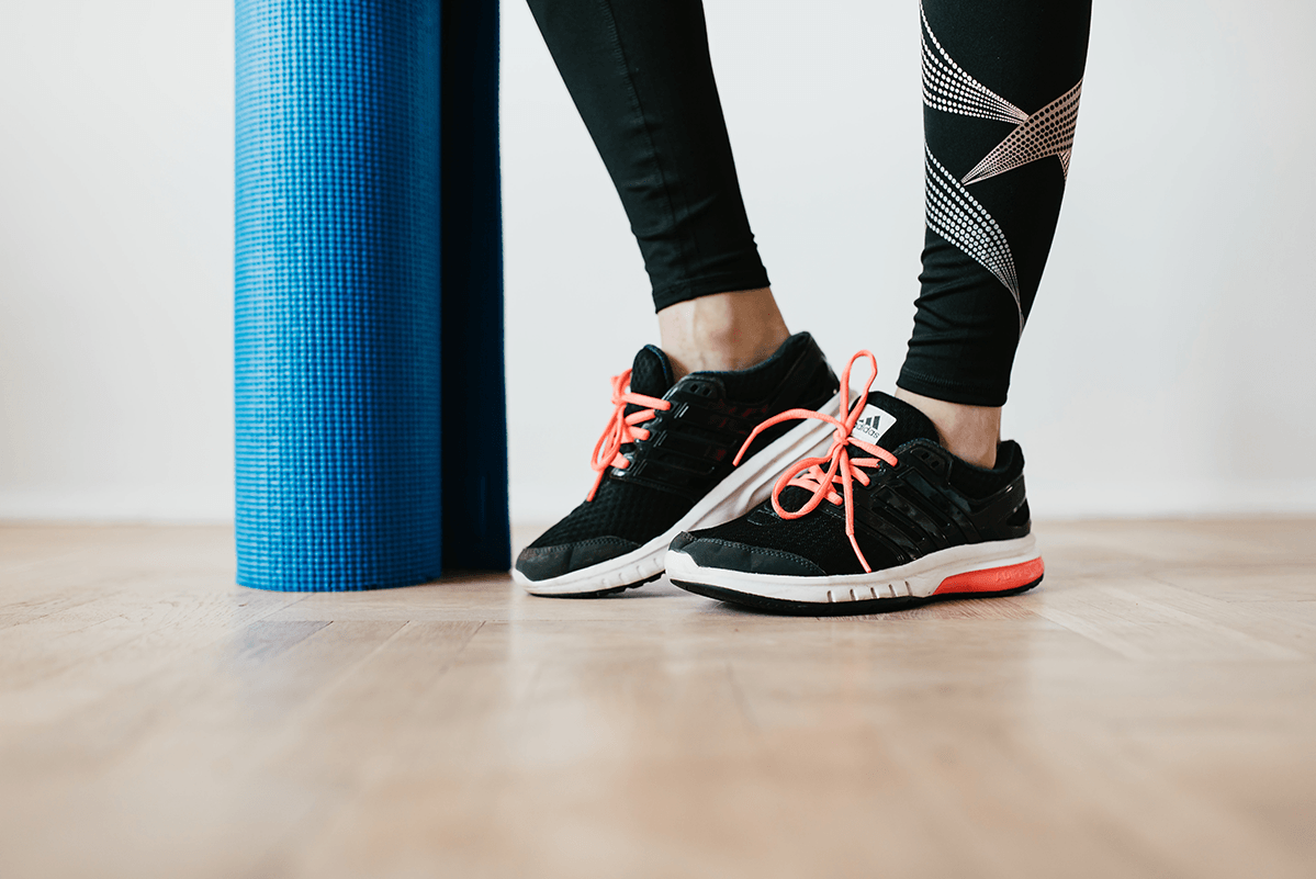 image: yoga mat and workout shoes
